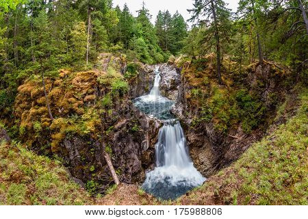 Wide angle perspective of Upper Falls at Little Qualicum Falls near Qualicum Beach and Parksville on Vancouver Island British Columbia Canada.