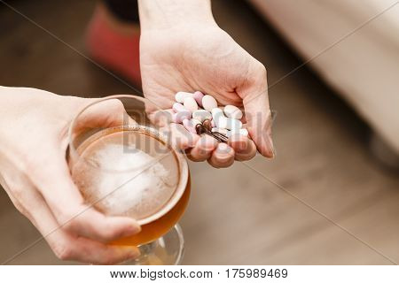 Addict Problem, Woman With Pills And Beer In Hands.