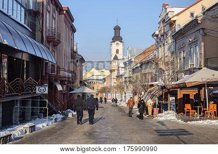 Uzhgorod Ukraine - January 29 2017: Old narrow street in center of Uzhgorod sunny winter day