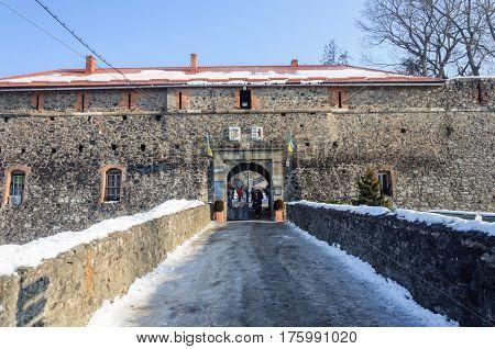 Uzhgorod Ukraine - January 29 2017: Gate of medieval castle in Uzhgorod. Sunny winter day.