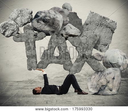 Businessman crushed by the weight of the boulders like taxes