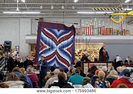 GORDONVILLE PENNSYLVANIA - March 11 2017: Amish volunteers help at the annual quilt auction which benefits the Fire Company.