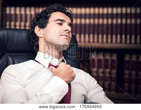 Businessman relaxing in his office