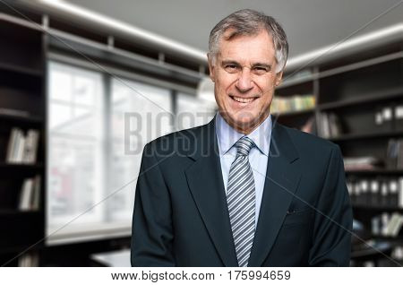 Portrait of a man in front of a book