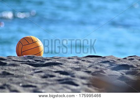 a beach volley ball placed on the sand