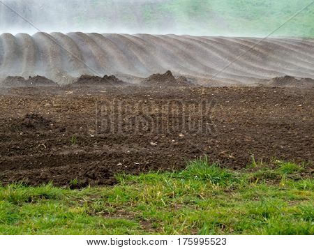Fog Lifting From A Freshly Ploughed Area Of Land - Farmwork