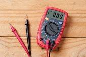 digital multimeter or multitester or Volt-Ohm meter an electronic measuring instrument that combines several measurement functions in one unit. poster
