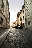 A small skinny street detail in the old town area of Prague, Czech Republic. poster