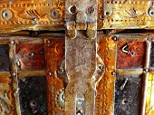 Iron-bound coffer from the last century. Old iron-bound coffer grandmother's. In such was stored dowry. Retro. poster