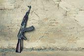 old submachine gun kalashnikov AK-47 against the wall poster