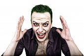 guy with crazy joker face, green hair and idiotic smike. carnaval costume. poster