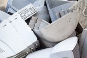 Obsolete computer monitors and keyboards on the landfill. poster