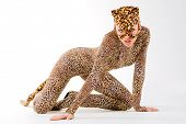 Hot beautiful model in latex leopardess costume poster