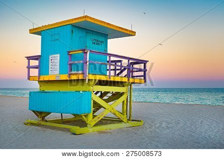 Iconic lifeguard tower at South Beach in Miami with a beautiful sunset sky