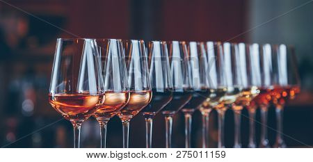 Wine Glasses In A Row. Buffet Table Celebration Of Wine Tasting. Nightlife, Celebration And Entertai