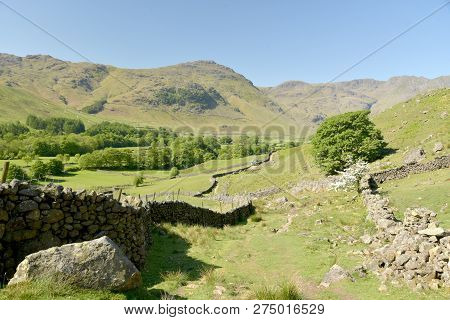Crinkle Crags above the head of Mickleden valley in the English Lake District poster