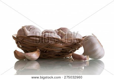 Fresh Raw Garlic In A Wicker Basket Isolated On White Background