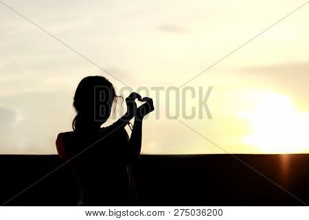 Silhouette Children Marking Love Symbol With Arms And Hands Over Sunset, Shadow Image Children In Ha