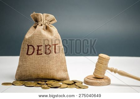 A Bag Of Money And The Word Debt And The Hammer Of The Judge. Payment Of Taxes And Of Debt To The St