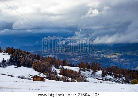 Early winter landscape with first snow in Alpe di Siusi. Dolomites, Italy