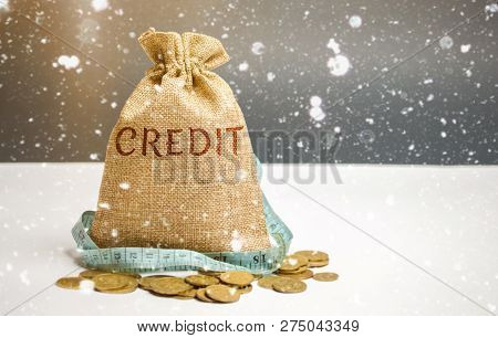 Bag With Money And Tape Measure And The Word Credit. Christmas Loans. Low Interest Rates. Favorable