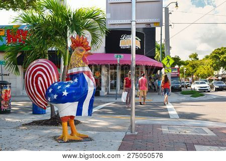 MIAMI,UNITED STATES - DECEMBER 3,2018 : The famous 8th street at Little Havana in Miami with the figure of a rooster displaying the cuban and the american flags