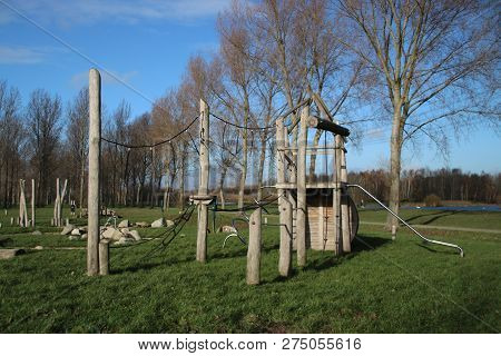Playground With Several Water Play Tools And Pull Ferry Over Ditch In The Public Park Hitland In Cap
