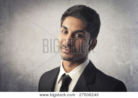 Smiling indian young businessman