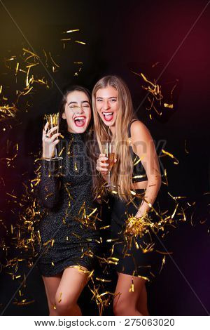 2 women celebrating at christmas or New Years party