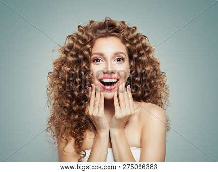 Exited Screaming Young Woman Portrait. Surprised Girl Student With Long Curly Hair. Surprise. Positi