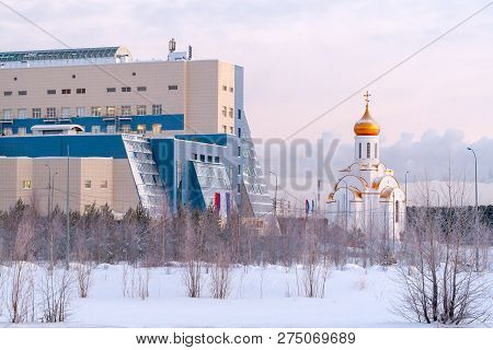 Russia, Surgut, 12/20/2018: Surgut University And The Church Of The Holy Martyr Tatiana In The Winte
