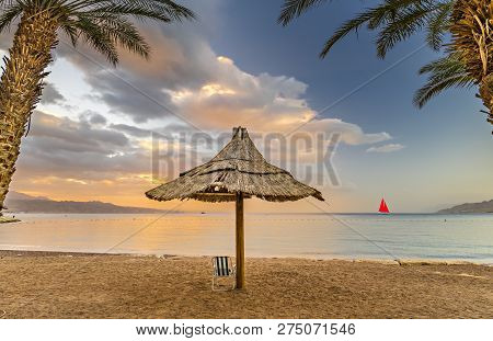 Public Beach In Eilat - Famous Tourist Resort And Recreational City In Israel  Symbolizing Vacation,