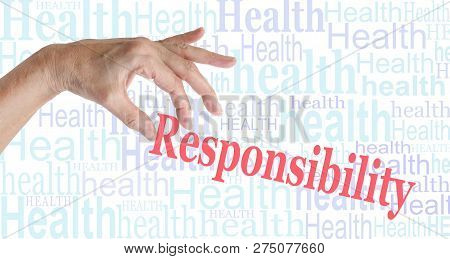 Take Responsibility For Your Health - Female Hand Picking Up The Word Responsibility Against A Backg