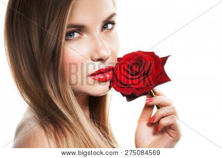 Beautiful young woman with red rose on white