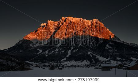 Sunset Glowing Peak Of Huge Alpine Mountain Chain In Tirol