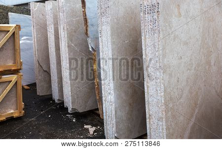 Side View Of The Edge Of The Granite Slab In Bulk. A Stack Of Granite Slabs - Marble Factory. Backgr