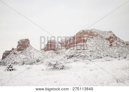 Snow In The Desert With Mountains In The Background.  Sedona, Az, Usa.