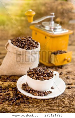 Cup Of Coffee Beans. Coffee Grinder And Bag With Coffee Beans In The Background. Coffee. Coffee Bean