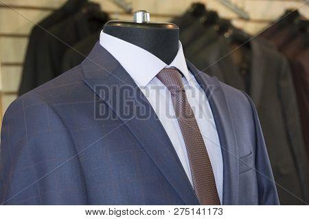 Man Suits, Jackets, Shirts, Ties. Modern Style. Elegant Clothes. Men Fashion Industry. Stylish Blue