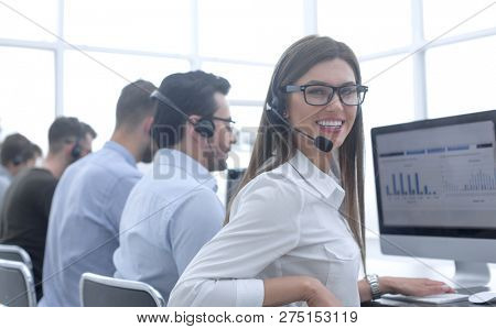 employee of the business center using the computers to analyze the data