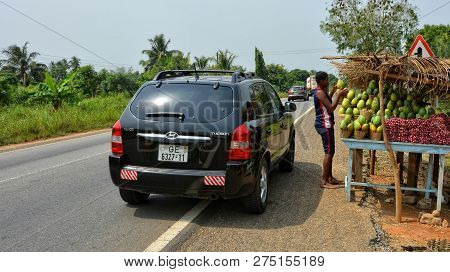 African Vendor Sells Fruits And Vegetables. Food On Display On A Country Road For A Sale. Market Sta