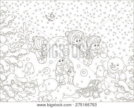 Small Children Playing In Their Toy Snow Fortress On A Playground In A Winter Snow-covered Park, Bla