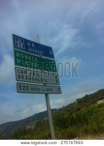 Monaco Travel Destination, Highway Road Sign. Vacation Road Sign Or Business Success Concept. Summer