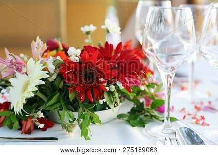 Decorated Table With Flowers In The Restaurant
