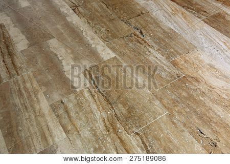 A Floor Made Of Rectangular Marble Slabs