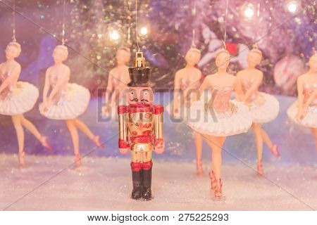 Christmas Nutcracker Toy Soldier And Balerina Dolls On The Stage. Famous Russian Ballet Installation