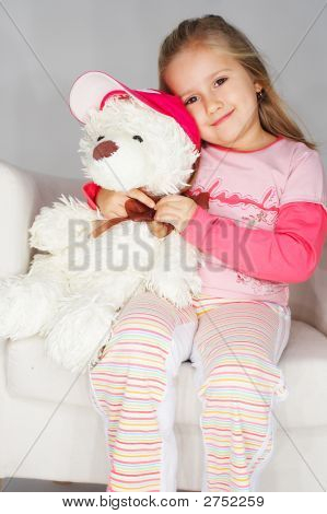 Nice Young Girl In Pink On Light Background