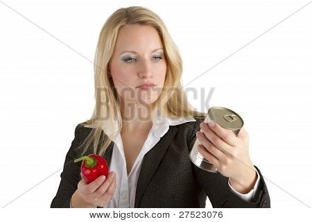 Woman Comparing Fresh To Tinned Vegetables
