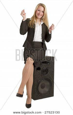 Happy Businesswoman Sitting On Speakers