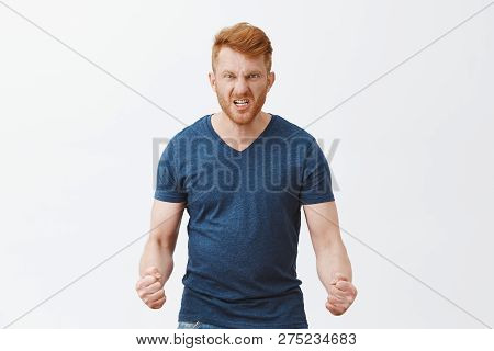 Guy Will Show How Anger Looks. Portrait Of Pissed And Angry Dangerous Redhead Guy With Outraged Expr